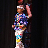 Dona Livingston nudges Ryder Allen, 5, Navajo, to the front of the stage during the Tiny Tot Pageant Monday, August 6, 2018 at El Morro Theatre.