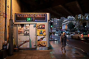 The Waterloo Grill fast food kiosk under the railway bridges near Waterloo station on 27th November 2019 in London, England, United Kingdom. This area, an important public transport hub, is particularly dark and seedy.