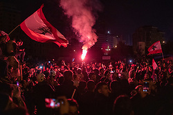 © Licensed to London News Pictures. 25/01/2020. Beirut, Lebanon. Demonstrators protest and light a flare on Riad Al Solh Square, Beirut, outside the Grand Serail (Government Palace), where it is reported that Lebanese Prime Minister Hassan Diab is living. Today marks the 100th day of demonstrations in Lebanon. Police used tear gas and water cannon to disperse the anti-government demonstrators, who are campaigning against government corruption and economic crisis. Photo credit : Tom Nicholson/LNP