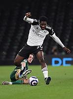 Football - 2020 / 2021 Premier League - Fulham vs Sheffield United - Craven Cottage<br /> <br /> Fulham's Ola Aina is fouled by Sheffield United's Billy Sharp.<br /> <br /> COLORSPORT/ASHLEY WESTERN