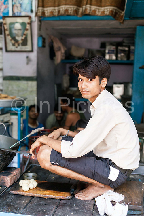 A boy frying Nagori (smal puri) at Ram Swarup, a shop which has been  serving up breakfasts in the old city for over 70 years Old Delhi, India