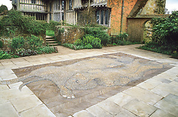 The mosaic garden at Great Dixter featuring a mosaic depicting Christopher Lloyd's dachshund dogs