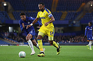 AFC Wimbledon midfielder Liam Trotter (14) taking on Juan Castillo of Chelsea (54) during the EFL Trophy match between U21 Chelsea and AFC Wimbledon at Stamford Bridge, London, England on 4 December 2018.
