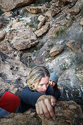 Sarah Hepola climbing boulders at Hueco Tanks State Park & Historic Site, El Paso, Texas. USA. Spotted by guide Jacob Garza.