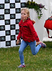 Isla Phillips runs as she attends the Land Rover Novice & Intermediate Horse Trials at Gatcombe Park on March 23, 2019.
