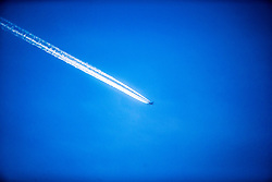 Aeroplane contrails in the sky over Dundee, Scotland, UK.