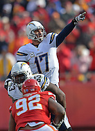 KANSAS CITY, MO - NOVEMBER 24:  Quarterback Philip Rivers #17 of the San Diego Chargers calls out instructions against the Kansas City Chiefs during the first half on November 24, 2013 at Arrowhead Stadium in Kansas City, Missouri.  San Diego won 41-38. (Photo by Peter Aiken/Getty Images) *** Local Caption *** Philip Rivers