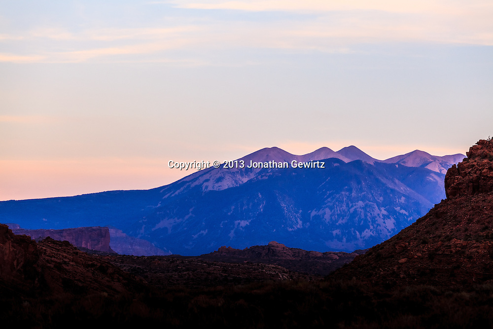 A section of the La Sal mountain range at twilight, as seen from the northern end of Arches National Park, Utah. WATERMARKS WILL NOT APPEAR ON PRINTS OR LICENSED IMAGES.
