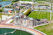Nederland, Flevoland, Lelystad, 07-05-2015. Oostvaardersdijk, Bataviahaven met appartementencomplex. In de achtergrond Bataviawerf en Fashion Outlet Bataviastad.<br /> Batavia harbour with luxury appartments.<br /> luchtfoto (toeslag op standard tarieven);<br /> aerial photo (additional fee required);<br /> copyright foto/photo Siebe Swart