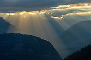Crepuscular Ray sunbeams through clouds over Glacier National Park, Montana