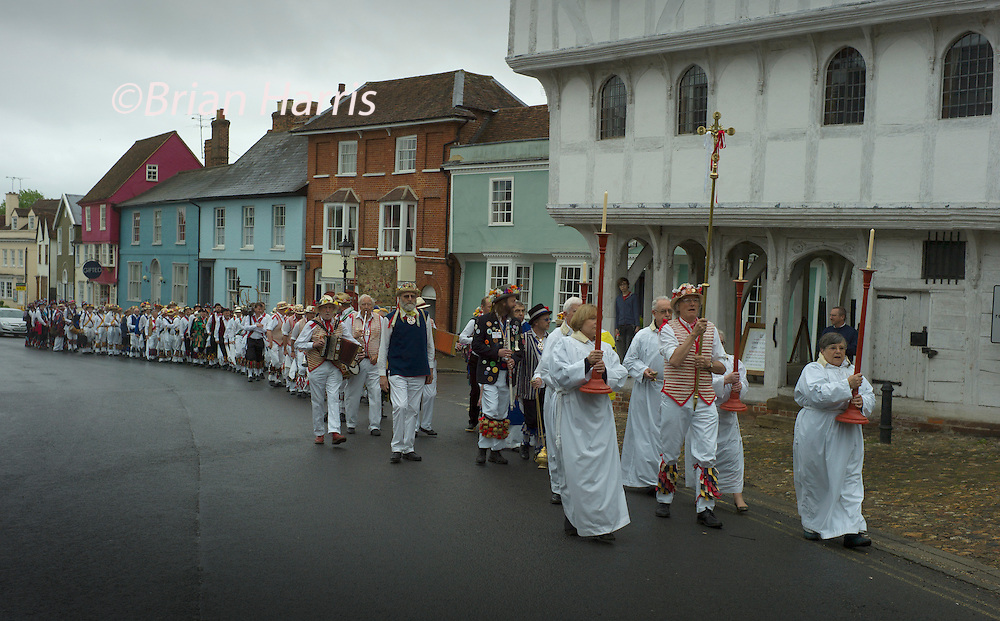 The Thaxted Morris Weekend, Thaxted and surrounding villages, Thaxted, Essex, England. 31 May 2015<br /> Seen here: Morris Dancers process from the 14th cent. ancient Guildhall in the centre of Thaxted to the Thaxted Church for morning service and offeratory dance.<br /> 21 teams or 'sides' of Morris Men including teams from Holland , Denmak and Australia danced through the villages such as Finchingfield in rural north Essex during the start of the 345th meeting of the member clubs of the Morris Ring and the 82nd meeting hosted by the Thaxted Morris Men.