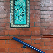 Victorian glazed ceramic panels by E Caldwell Spruce of Burmantofts Art Pottery, Leeds set in terracotta tiles, Blackpool Tower, Lancashire.