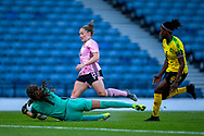 Sydney Schneider (#1) of Jamaica gets down low to gather the ball from the feet of Kim Little (#8) of Scotland during the International Friendly match between Scotland Women and Jamaica Women at Hampden Park, Glasgow, United Kingdom on 28 May 2019.