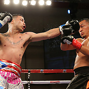 KISSIMMEE, FL - MARCH 06:  Charles Natal (L) throws a jab to the face of Juan Aguirre during the Telemundo Boxeo boxing match at the Kissimmee Civic Center on March 6, 2015 in Kissimmee, Florida. (Photo by Alex Menendez/Getty Images) *** Local Caption ***  Charles Natal; Juan Aguirre