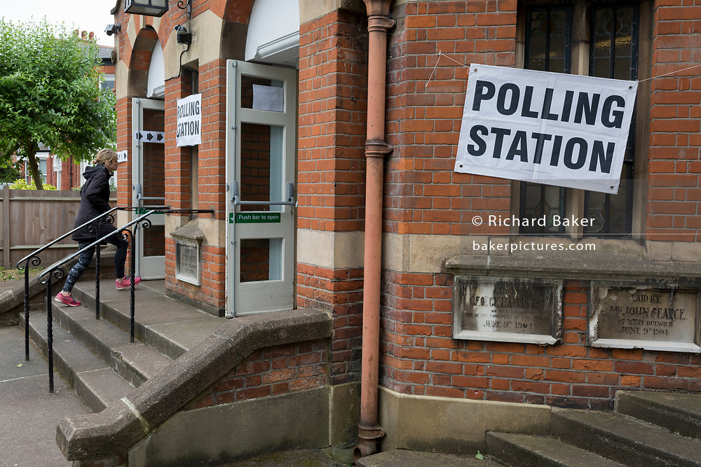 A voter enters a polling station on the morning of the UK's 2017 general elections outside the Edwardian-era Baptist church in Half Moon Lane in herne Hill, on 8th June 2017, in London, England.