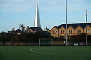 View across all-weather sports ground at John Orwell Sports Centre in Wapping, looing towards The Shard on 17th January 2020 in London, United Kingdom. The centre provides hockey pitches, and other facilities for the local community.