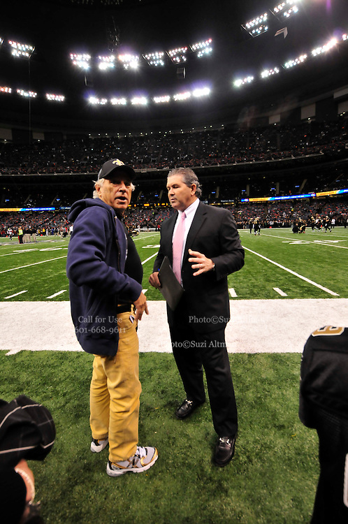 """Description/Caption:<br /> File-Greg Williams, Defensive Coordiantor for the New Orleans Saintshas been suspended indefiently from the NFL because of his """"bounty system"""" he had in place while coaching for the Saints during ht e2009,2010 & 2011 NFL seasons. Coach Sean Payton was suspended for one year and General manager Micky Lookis was suspended for 8 games for thier roles in the """"Bounty scandal"""". File Photo of Defensive coach Greg Willams letting his defensive line know what to do during the Saints pre season game against the San Diego Chargers Friday Aug 27,2010. The San Diego charges cut Drew Brees a few years ago, allowing him to be picked uop by the Saints as a free agent. The Saints won 36-21 at half time.Photo© Suzi Altman"""