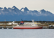 Glacier-clad peaks on a Chilean island lie across Beagle Channel from Ushuaia airport and port. Ushuaia is capital city of Tierra del Fuego Province, Argentina, South America.