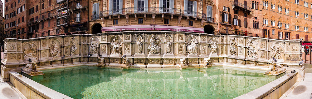Panoramic view of Fonte Gaia in Piazza Del Campo in Siena Tuscany by day