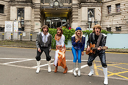 © Licensed to London News Pictures. 14/05/2021. LONDON, UK.  The cast of ABBA MANIA perform at a photocall outside Waterloo station ahead of their West End return to Shaftesbury Theatre later this month as lockdown restrictions are eased slightly and audiences can come back. ABBA MANIA is the world's number one touring ABBA tribute and has performed in over 30 countries around the world over the last two decades. It is 47 years after Swedish supergroup ABBA's Waterloo triumphed at the Eurovision Song Contest. (L to R) Duncan Walsh-Atkins as Benny, JoJo as Anni-Frid (Frida), Tamsin Stewart as Agnetha, Edward Handoll as Bjorn.   Photo credit: Stephen Chung/LNP