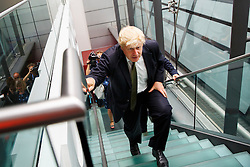 © Licensed to London News Pictures. 06/08/2014. LONDON, UK. Mayor of London, Boris Johnson leaving Bloomberg HQ in central London after delivering a speech on Europe and confirming intention to stand as an MP for the Conservative Party at the next general election. Photo credit : Tolga Akmen/LNP