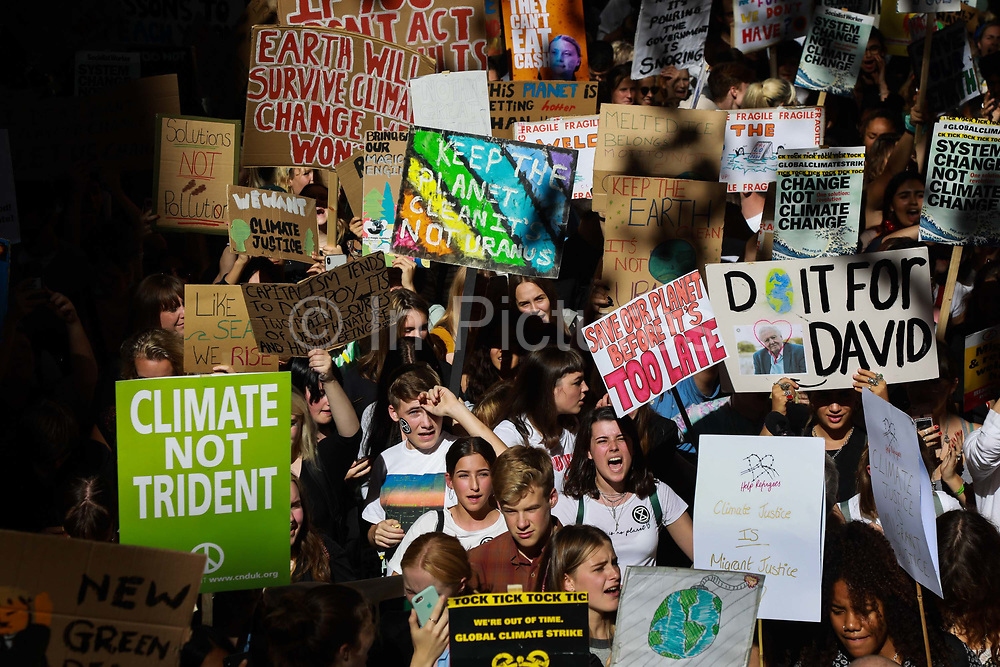 Tens of thousands took to the streets in Central London taking part in the the Global Climate Strike, September 20th 2019, London, United Kingdom.  The day of strike for the climate was a global event with millions taking part across the globe. The strike was inspired by Greta Thunberg, a Swedish school girl who started the first school strike for the climate. Her action inspired school children across the world to go on strike demanding radical climate change policies to save their future. On September 20th adults aand children alike went out on strike to demand radical political change and climate justice. The day included speeches and a march through central London.