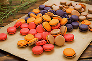 A tray of colourful Macaroons. A macaroon is a small cake or cookie, typically made from ground almonds (the original main ingredient), coconut or other nuts (or even potato), with sugar and sometimes flavorings (e.g. honey, vanilla, spices), food coloring, jam or a chocolate coating.