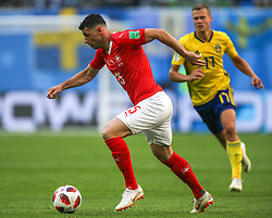 July 3, 2018 - Saint Petersburg, Russia - Blerim Dzemaili (L) of the Switzerland national football team and Viktor Claesson of the Sweden national football team vie for the ball during the 2018 FIFA World Cup match, Round of 16 between Sweden and Switzerland at Saint Petersburg Stadium on July 03, 2018 in St. Petersburg, Russia. (Credit Image: © Igor Russak/NurPhoto via ZUMA Press)