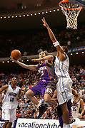 January 24, 2006, Orlando, Florida, USA;  Steve Nash(13) of the Phoenix Suns goes up for a shot as Tony Battie(4) of the Orlando Magic defends in the Magic 111-102 victory.