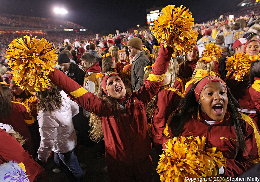 November 18, 2011: Iowa State Cyclones cheerleaders celebrate after the end of the NCAA football game between the Oklahoma State Cowboys and the Iowa State Cyclones at Jack Trice Stadium in Ames, Iowa on Friday, November 18, 2011. Iowa State upset Oklahoma State 37-31 double overtime.