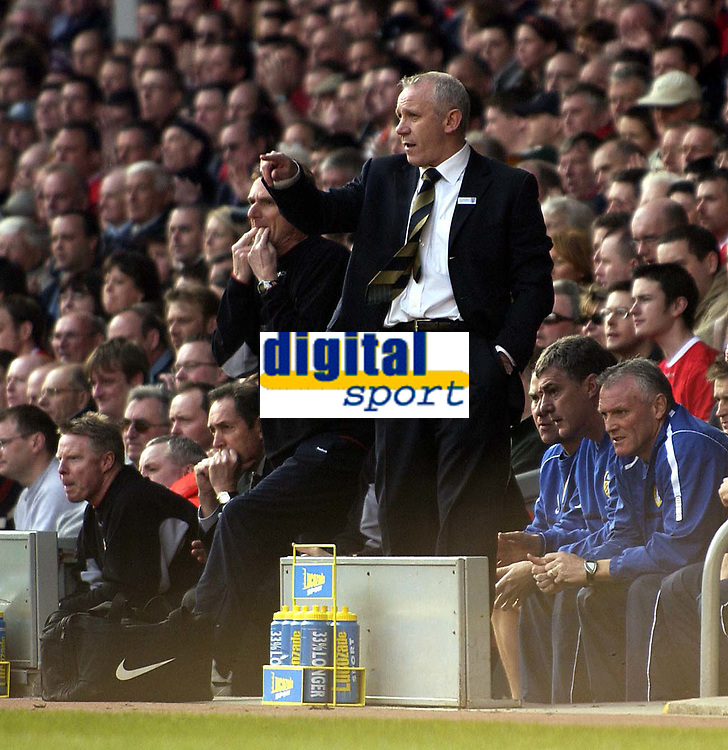 Photo. Jed Wee<br />Liverpool v Leeds United, FA Barclaycard Premiership, Anfield, Liverpool. 23/03/2003.<br />The benches of both teams show anxiety at a tight stage of the game, as new Leeds manager Peter Reid tries to get a point across to one of his charges.
