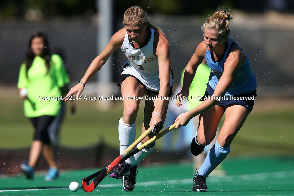 25 October 2014: Wake Forest's Jess Newak (3) and North Carolina's Emma Bozek (right). The University of North Carolina Tar Heels hosted the Wake Forest University Demon Deacons at Francis E. Henry Stadium in Chapel Hill, North Carolina in a 2014 NCAA Division I Field Hockey match. UNC won the game 3-1.