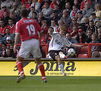 Photo. Glyn Thomas<br />Charlton Athletc v Liverpool. Barclaycard Premiership.<br />The Valley, Charlton. 28/09/2003.<br />John Arne Riise (R) passes the ball upfield to assist Smicer in scoring Liverpool's first goal.