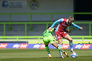 Scunthorpe United John McAtee (45) Forrest Green Rovers Ebou Adams (8) battles for possession during the EFL Sky Bet League 2 match between Forest Green Rovers and Scunthorpe United at the New Lawn, Forest Green, United Kingdom on 17 April 2021.