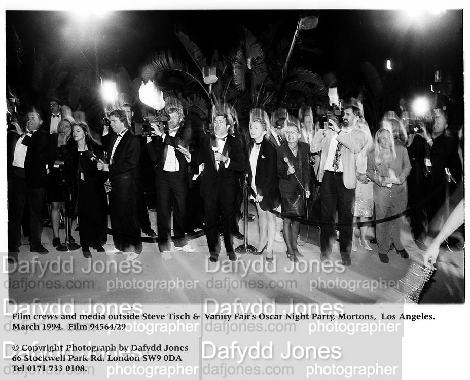Film crews and media outside Steve Tisch &  Vanity Fair's Oscar Night Party,<br />Mortons,  Los Angeles. March 1994.  Film 94564/29<br /> <br />© Copyright Photograph by Dafydd Jones<br />66 Stockwell Park Rd. London SW9 0DA<br />Tel 0171 733 0108.