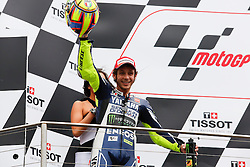 © Licensed to London News Pictures. 20/10/2012. Valentino Rossi (ITA) riding for the Yamaha Factory Racing celebrates after coming 3rd during the Race day of the round 16 2013 Tissot Australian Moto GP at the  Phillip Island Grand Prix Circuit Victoria, Australia. Photo credit : Asanka Brendon Ratnayake/LNP