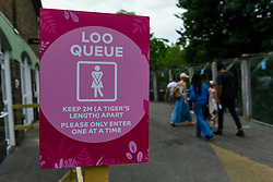 © Licensed to London News Pictures. 15/06/2020. LONDON, UK. A social distancing sign at the toilets on the reopening day of ZSL London Zoo, the first day that the zoo has been open to the public since March following the coronavirus pandemic lockdown. The staff have applied social distancing signage around the premises for the safety of visitors. The UK government has relaxed Covid-19 restrictions allowing non-essential shops, zoos and safari parks to reopen to the public from 15 June.  Photo credit: Stephen Chung/LNP