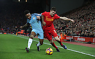 James Milner of Liverpool and Raheem Sterling of Manchester City during the English Premier League match at Anfield Stadium, Liverpool. Picture date: December 31st, 2016. Photo credit should read: Lynne Cameron/Sportimage