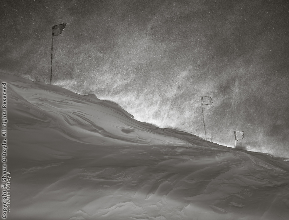 Hiding behind a drift while the wind blown snow blasts above. Temperature was minus 26 f. with a windchill of minus 51.