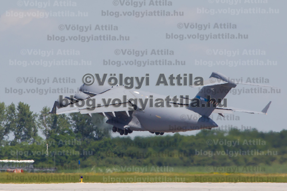 C-17 aircraft of the NATO Heavy Airlift Wing takes off with Anders Fogh Rasmussen secretary general of NATO and Csaba Hende Defence minister of Hungary on board after they opened a new hangar construction area of the Strategic Airlift Capability (SAC) programme in Papa (about 165 km west of Budapest), Hungary on July 01, 2013. ATTILA VOLGYI