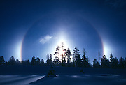Ice crystals refracting early morning sun and creating the atmospheric phenomenon of  sun dogs or parhelias, Bryce Canyon National Park, Utah.