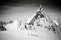 A group of skiers climb toward the Vignettes Hut along the classic Haute Route in Switzerland.