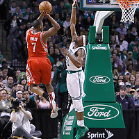 06 March 2012: Houston Rockets point guard Kyle Lowry (7) takes a jumpshot over Boston Celtics point guard Keyon Dooling (51) during the Boston Celtics 97-92 (OT) victory over the Houston Rockets at the TD Garden, Boston, Massachusetts, USA.
