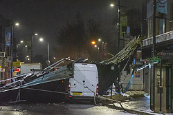 © Licensed to London News Pictures. 15/01/2020. Slough, UK. A van sits under a huge section of metal roof on the High Street in Slough after winds from storm Brendon tore it from the top of a building. Photo credit: Peter Manning/LNP