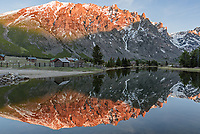 The last light on Sylvan Peak is reflected in the outlet of East Rosebud Lake. There are over 60 cabins scattered around this lake, which are part of the private community of Alpine.