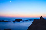 Rocky Mediterranean shore at sunset