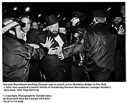 Norman Rosenbaum pushing through cops to march across Brooklyn Bridge to City Hall. ( After Jury acquited Lemrick Nelson of murdering  Norman Rosenbaum's younger brother.) New York. 1992. Film 92935/36<br />© Copyright Photograph by Dafydd Jones<br />66 Stockwell Park Rd. London SW9 0DA<br />Tel 0171 733 0108