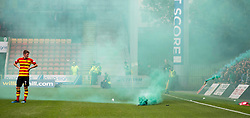 Partick Thistle's Blair Spittal looks on as Celtic fans throw a flare onto the pitch during the Betfed Cup Second Round match at the Energy Check Stadium at Firhill, Glasgow.