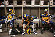 Milpitas High School defensive back Tony Phan Nguyen, 24, adjust his uniform before taking on Valley Christian High School during Friday Night Lights at Levi's Stadium in Santa Clara, California, on September 18, 2015.  Milpitas went on to lose 22-21 against Valley Christian.  (Stan Olszewski/SOSKIphoto)