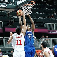 04 August 2012: France Mickael Gelabale takes a jumpshot over Tunisia Mokhtar Ghayaza during 73-69 Team France victory over Team Tunisia, during the men's basketball preliminary, at the Basketball Arena, in London, Great Britain.